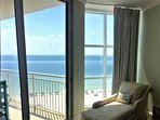 Enjoy the master bedroom chaise, perfect for beach watching or reading your favorite book.