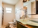 Beautiful guest bath with a walk in shower.
