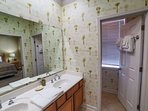 Large master bath with dual sinks, separate shower and lavatory, lots of counter space.