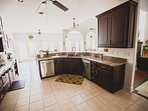 Kitchen overlooks great room. Two dishwashers, instant hot, Kurig Coffee Maker