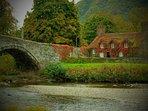 Llanwrst tea rooms by Pont Fawr, a narrow three-arch stone bridge dated 1636.