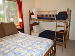 Upper level bedroom with a Double bed and a Twin bunk bed