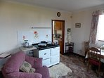 Living area Showing Aga cooker. (Only used in winter months) Electric cooker in kitchen area.