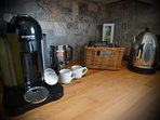 Nespresso espresso/frother machines. Variety of teas. Optional initial grocery start up package.