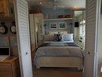 Separate Bedroom with queen, pillow top mattress. High quality linens, down duvet/ pillow options.