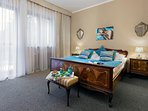 Garden view Queen Bedroom with a balcony and en suite with a double bedroom