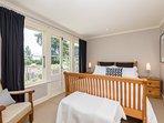 Queen bedroom gets  morning sun, overlooks orchard