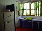 Kitchen with all the amenities -- 2 refrigerators, toaster oven, blender, plates, cutlery, etc