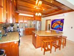Kitchen features convenient island/  breakfast bar for entertaining and additional seating