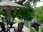 Grab your favorite beverage & head for your seat at the back patio overlooking the Boquet River.