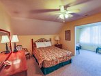 Upstairs bedroom has queen size bed.  There are two twin beds in the adjacent alcove.