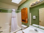 Full bath upstairs has skylight.  Towels and washcloths will be provided.