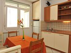 Apartment IVA - kitchen with dining corner and entrance to private balcony