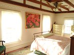 The Crow's Nest features a super comfortable Full sized Iron Bed, sunny windows, and a private Bath.