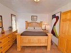 Upstairs bedroom with queen size bed. Downstairs bedroom with full size bed.