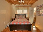 Queen size bed in second bedroom leading into full bath