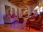 Living room with kiva fireplace