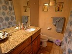 Second bathroom with Jacuzzi tub and shower