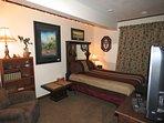 Cozy bedroom featuring Ben's cartoon art