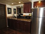 Full kitchenette with breakfast in the fridge.  You are welcome to bring your own lunch or dinner.