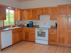 Full kitchen with electric range, dishwasher, and lots more