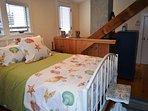 Bedroom 3: Queen master bedroom with a deck.