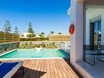 Private swimming pool area with sun beds