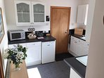 Fully equipped kitchen,  toaster, kettle, cooker, hob, fridge, microwave etc.