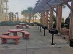 Outdoor grills are located beside the condo for guest use
