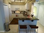 Kitchen is Outfitted with Granite Counter tops and Top Of The Line Appliances
