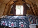 This cabin is intended for one, and features a REGULAR LENGTH twin size bed