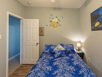 Bedroom downstairs w/ queen size bed 12 inch foam mattress & 32 inch smart TV
