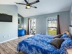 Master bedroom w/ 40 inch smart TV, reading nook, balcony, full private bathroom