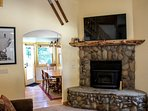 Rio Vista Log Cabin Retreat  - Living room with fireplace and TV