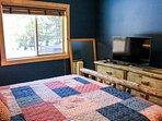 Rio Vista Log Cabin Retreat  - Master bedroom with TV