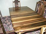 2nd fl dining table and chairs for 6, hand crafted from Blue Mahoe, (national wood.)