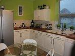 View of kitchen. American style fridge freezer