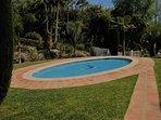 Children's pool set in enclosed lush gardens.