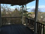 Covered porch with Bistro set and BBQ grill