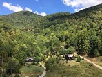 Ariel of Milima ranch and the only two cabins on the 400 acre mountain property.