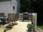 Deck with gas grill.