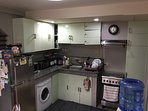 complete kitchen with clothes washer