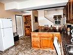 Kitchen / White door to garage