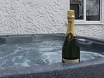 The hot tub is located in the court yard which also provides a barbecue and garden furniture