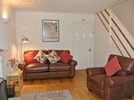 Lounge at Cottage Too. New leather sofa and chair.