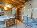 Spacious en-suite bathroom with a rain shower