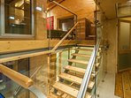 Indoor wooden and metal staircase leads you to lounge area.  A ramp for disable people is provided