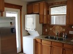 Brand new refrigerator and conveniently-sized washer/dryer unit