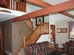Alternate view of living room with stairs leading to the loft sitting area and loft bedroom.