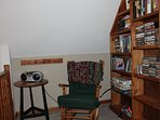 Loft sitting area.  Plenty of books, games, and DVD's